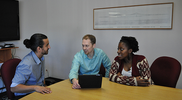 Professor Reinholz works on the EQUIP app with two doctoral students